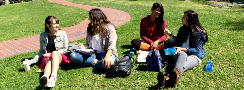 Female students have a picnic on lower quad