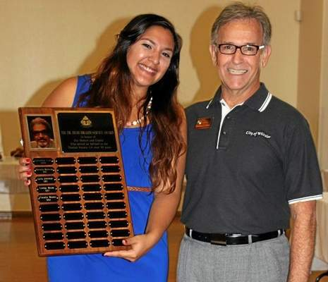 Thalian Society member Claudia Munoz was presented with the Dr. Hilmi Ibrahim Award for her volunteerism by Whittier Councilman Owen Newcomer