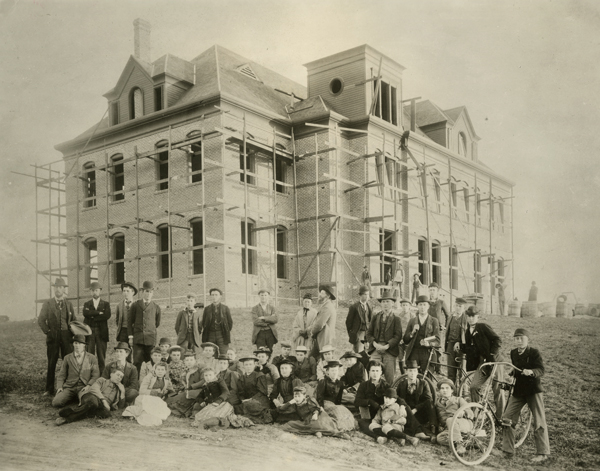 Academy students and faculty in front of Founders Hall during construction in 1894
