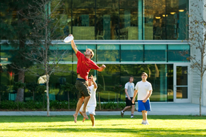 Student take part in a frisbee game outside of Wardman Library.