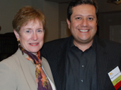 City Administrative Office and Whittier alumnus Miguel Santana strikes a pose with President Sharon D. Herzberger.