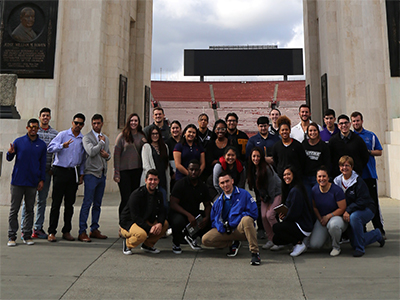 A kinesiology class and Professor Kathy Barlow pose for a group photo at L.A. Coliseum.