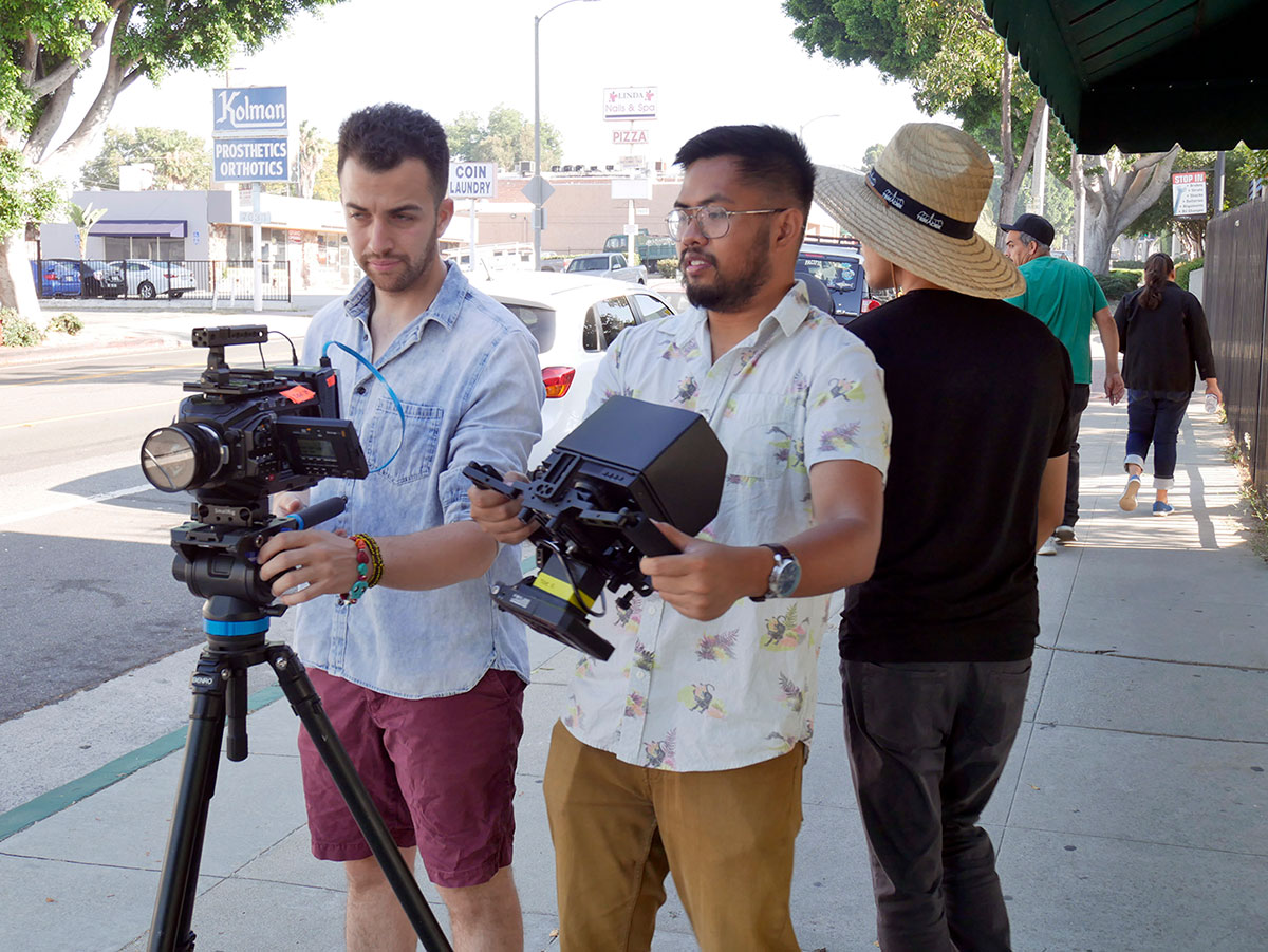 Recent alumni and students work on a film project in Whittier.