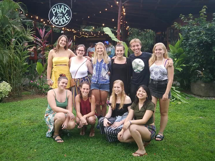 A group photo outside a Costa Rican restaurant.