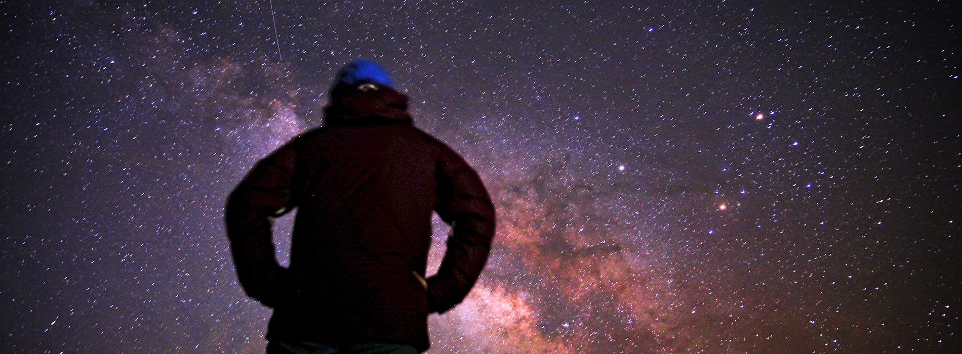Person looks up at the stars.