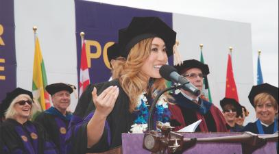 Cassey Ho delivers a speech at a podium.