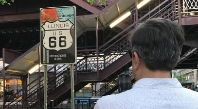 Miguel Santana looking at a Route 66 sign at the fair