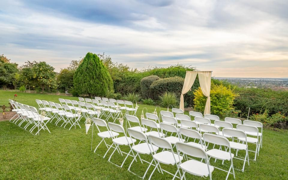 Lawn ceremony set up with city view in the background
