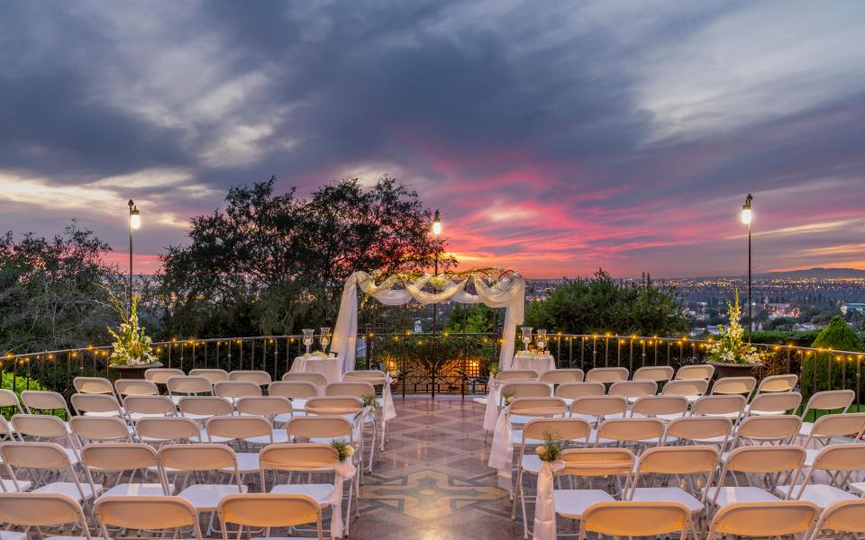 A terrace ceremony set up at sunset