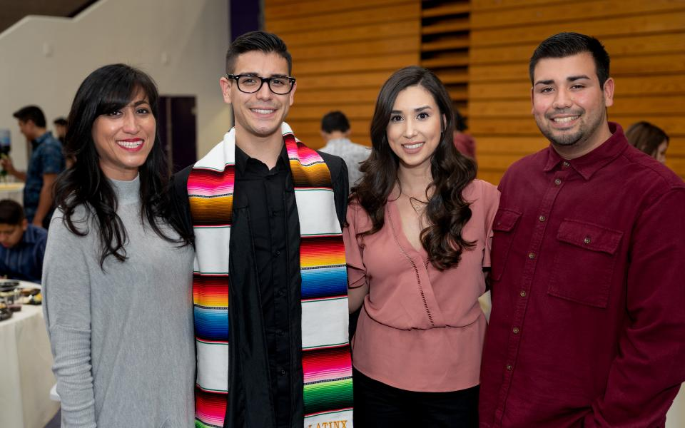 graduate with family/friends
