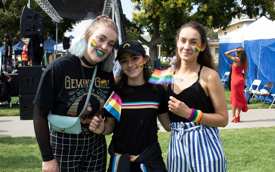 Three people at the City of Whittier's pride festival.