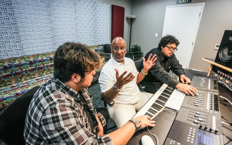 Professor and students in music studio